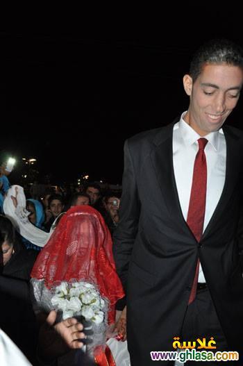 صور حفل زفاف اطول رجل فى العالم على سيدة قصيرة جدا ghlasa1382957913282.jpg