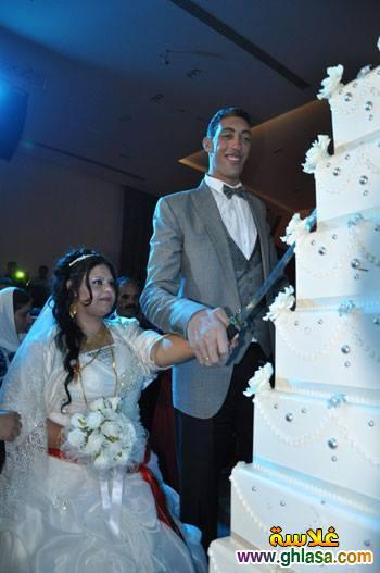 صور حفل زفاف اطول رجل فى العالم على سيدة قصيرة جدا ghlasa138295791347.jpg